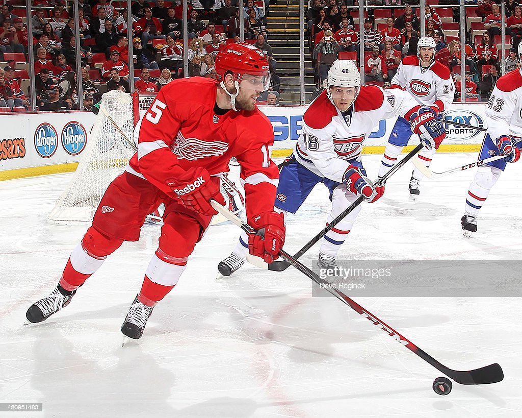 <a gi-track='captionPersonalityLinkClicked' href=/galleries/search?phrase=Riley+Sheahan&family=editorial&specificpeople=7029365 ng-click='$event.stopPropagation()'>Riley Sheahan</a> #15 of the Detroit Red Wings skates with the puck as <a gi-track='captionPersonalityLinkClicked' href=/galleries/search?phrase=Daniel+Briere&family=editorial&specificpeople=201624 ng-click='$event.stopPropagation()'>Daniel Briere</a> #48 of the Montreal Canadiens pressures him during an NHL game on March 27, 2014 at Joe Louis Arena in Detroit, Michigan.