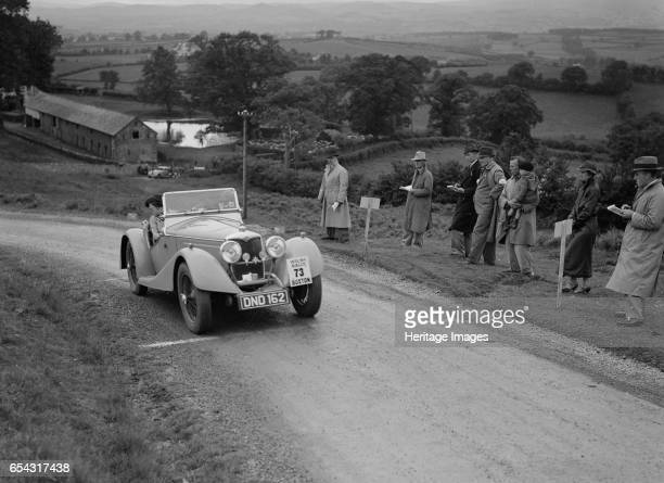 Riley Sprite 2seater of Mrs TB Hague competing in the South Wales Auto Club Welsh Rally 1937 Artist Bill Brunell Riley Nonbirdcage Sprite 2seater...