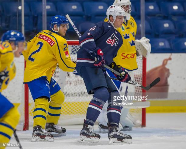 Riley Tufte of the USA battles for position with Timothy Liljegren of Sweden during a World Jr Summer Showcase game at USA Hockey Arena on August 2...