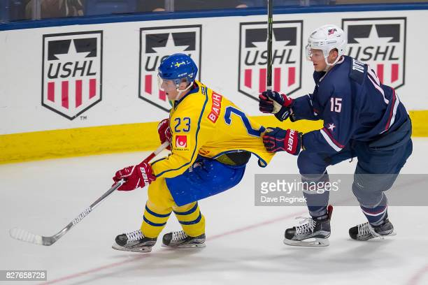 Riley Tufte of the USA grabs the jersey of Jesper Sellgren of Sweden during a World Jr Summer Showcase game at USA Hockey Arena on August 2 2017 in...