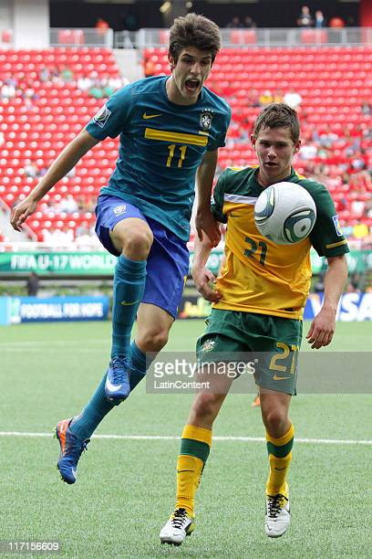 Riley Woodcock of Australia struggles for the ball with Lucas Piazon of Brazil during a match as part of the FIFA U17 World Cup Mexico 2011 Group F...