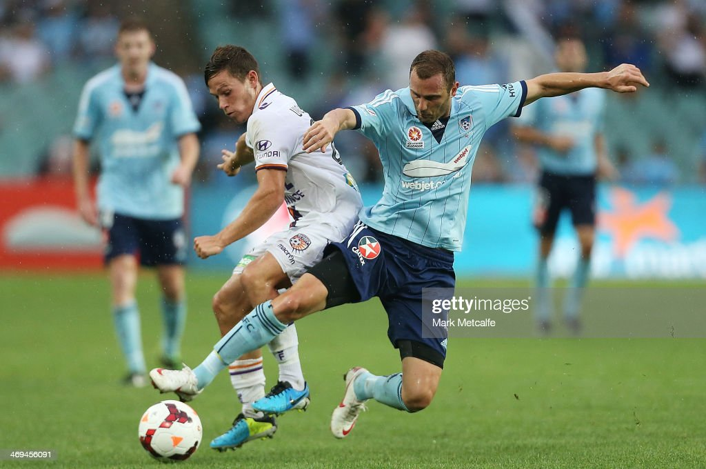 Riley Woodcock of the Glory and Ranko Despotovic of Sydney compete for the ball during the round 19 ALeague match between Sydney FC and Perth Glory...