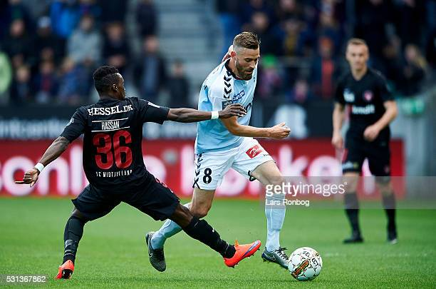 Rilwan Hassan of FC Midtjylland and Janus Drachmann of Sonderjyske compete for the ball during the Danish Alka Superliga match between FC Midtjylland...