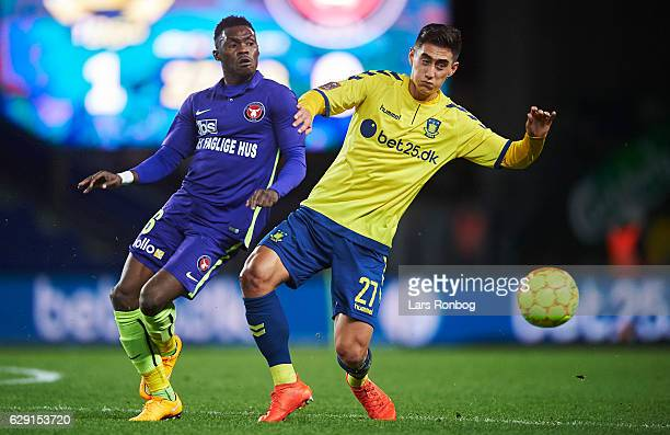 Rilwan Hassan of FC Midtjylland and Svenn Crone of Brondby IF compete for the ball during the Danish Alka Superliga match between Brondby IF and FC...