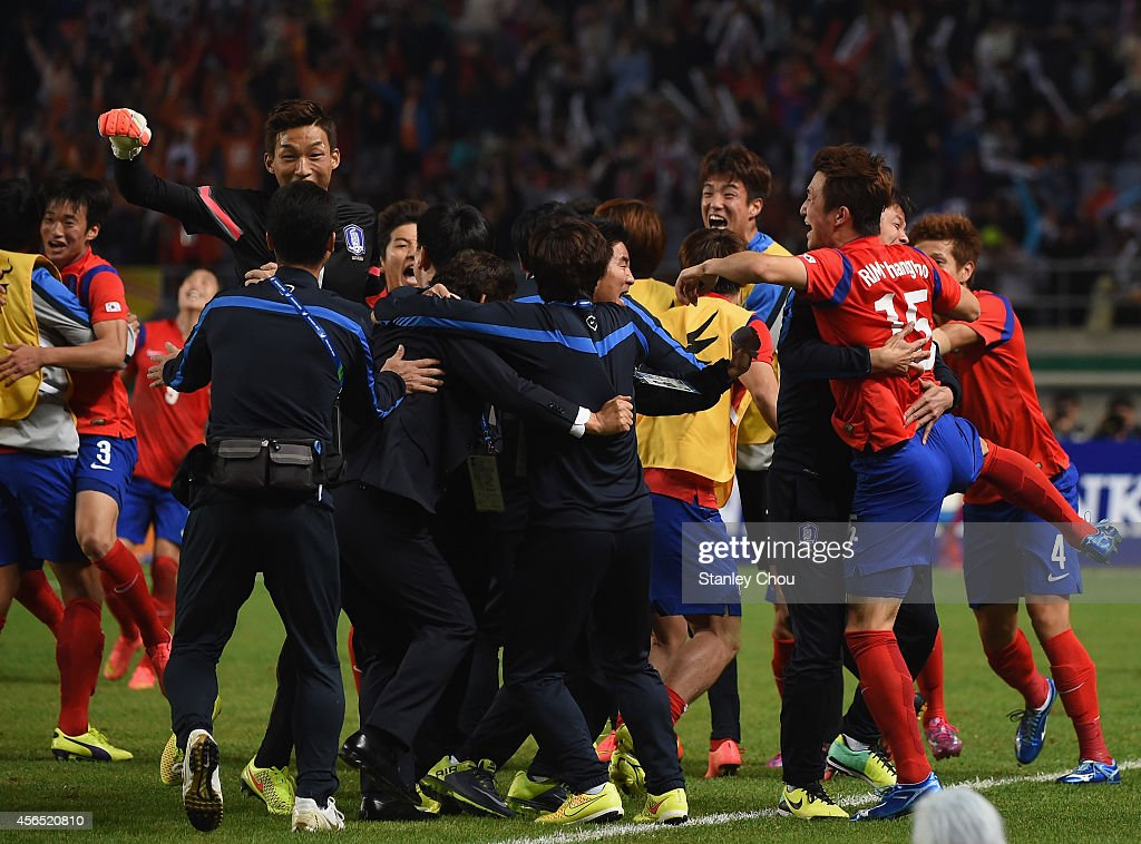 Rim Changwoo (1st R) of South Korea celebrates scoring his team's first goal with his teammates during the Football Men's Gold Medal match between South Korea and North Korea during day thirteen of the 2014 Asian Games at Munhak Stadium on October 2, 2014 in Incheon, South Korea.