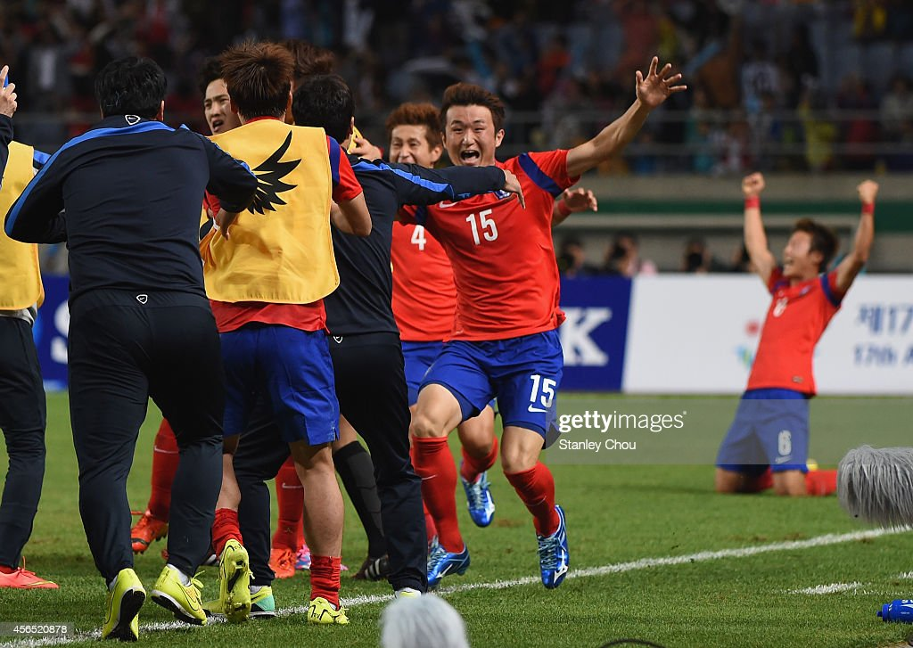 Rim Changwoo (2nd R) of South Korea celebrates scoring his team's first goal during the Football Men's Gold Medal match between South Korea and North Korea during day thirteen of the 2014 Asian Games at Munhak Stadium on October 2, 2014 in Incheon, South Korea.