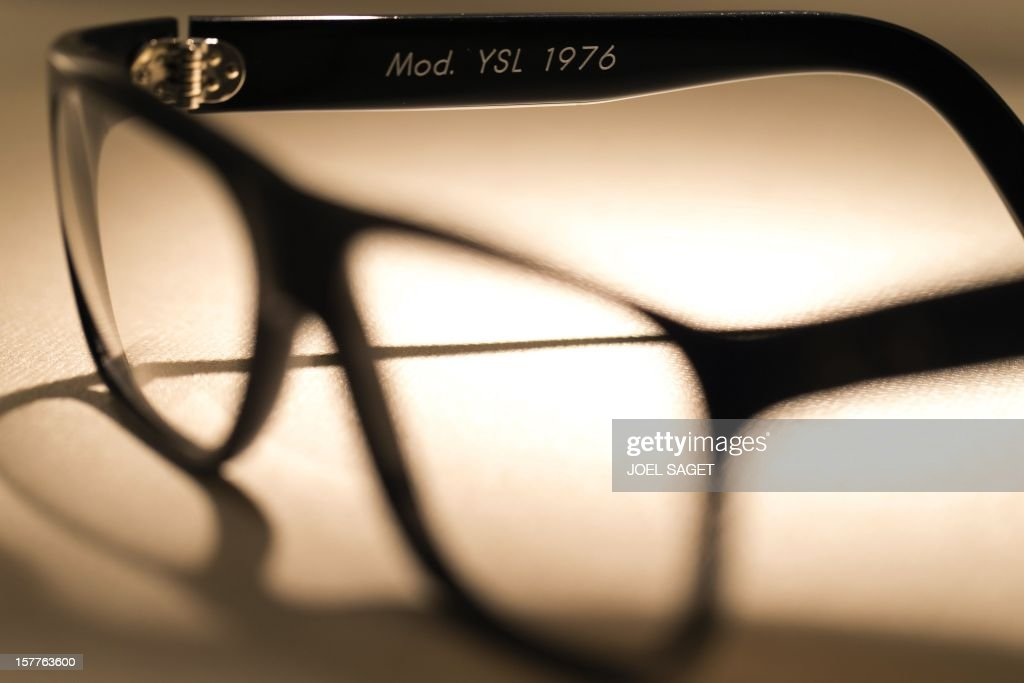 A rim glasses design Yves Saint-Laurent made by the Maison Bonnet is displayed at the group's store in Paris on December 6, 2012. AFP PHOTO / JOEL SAGET