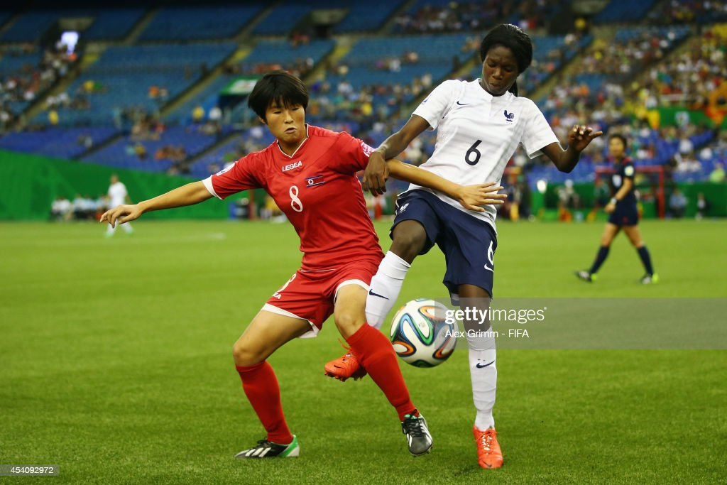 Rim Se Ok 8l9 of Korea DPR is challenged by Aminata Diallo of France during the FIFA U-20 Women's World Cup Canada 2014 3rd place match between Korea DPR and France at Olympic Stadium on August 24, 2014 in Montreal, Canada.