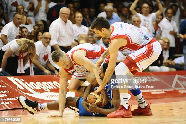 Rimantas Kaukenas and Andrea Cinciarini of Grissin Bon competes with Jerome Dyson of Banco di Sardegna during the match of LegaBasket Serie A playoff...