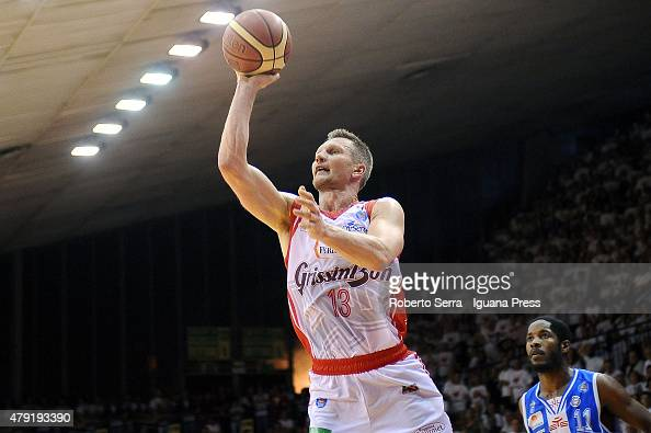 Rimantas Kaukenas of Grissin Bon competes with Jerome Dyson of Banco di Sardegna during the match of LegaBasket Serie A game 7 of playoff's final...