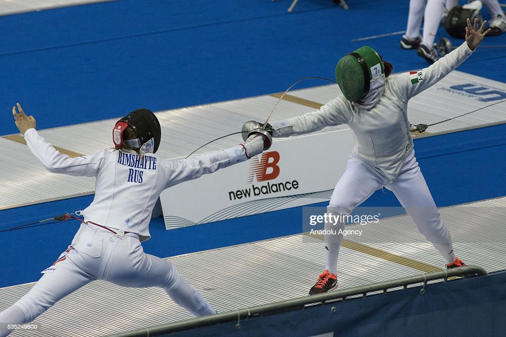 Rimsaite Donata (L) from Russia and Bonessio Lavinia from Italy compete in the fencing at the mixed relay World Championship in modern pentathlon in Olympic Sports Complex in Moscow, Russia, on May 29, 2016.