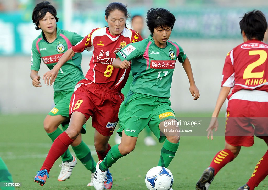 Rin Sumida of NTV Beleza and Homare Sawa of INAC Kobe Leonessa compete for the ball during the Nadeshiko League Cup Final match between NTV Beleza and INAC Kobe Leonessa at NACK 5 Stadium Omiya on September 9, 2012 in Saitama, Japan.