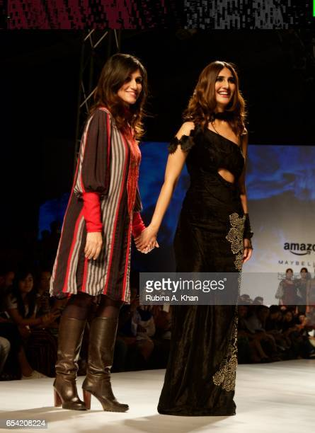 Rina Dhaka with her showstopper Bollywood actress Vaani Kapoor at Jawaharlal Nehru Stadium on March 16 2017 in New Delhi India