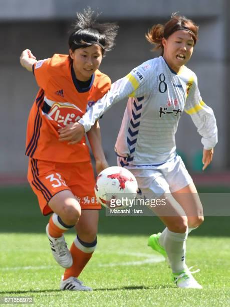 Rina Kosuda of Albirex Nigata and Hina Sugita of INAC Kobe Leonessa compete for the ball during the Nadeshiko League match between Albirex Niigata...