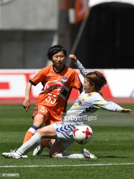 Rina Kosuda of Albirex Nigata and Miki Ito of INAC Kobe Leonessa compete for the ball during the Nadeshiko League match between Albirex Niigata...