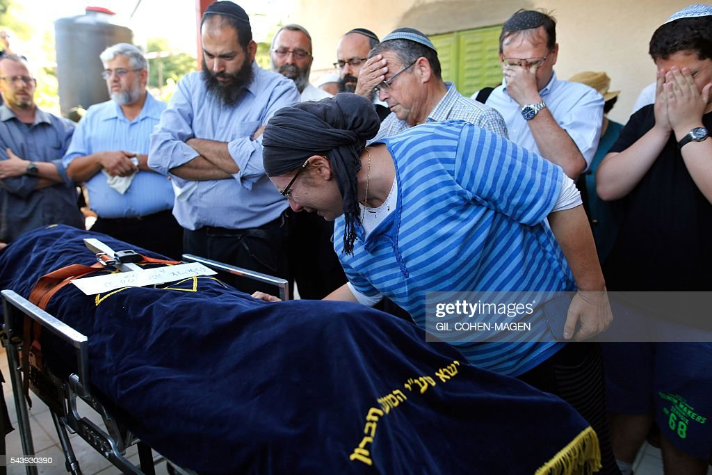 Rina (2-R) the mother Israeli Hallel, a 13-year-old girl who was fatally stabbed by a Palestinian attacker in her home, mourns during her funeral in the Kiryat Arba settlement outside the Israeli occupied West Bank city of Hebron on June 30, 2016. The Israeli army said that a young Palestinian killed Hallel in her bed after breaking into her home in the Kiryat Arba settlement outside the flashpoint city of Hebron. Security personnel rushed to the house and fired on the attacker, who wounded a guard before being shot dead, the army said. The girl was taken to hospital in Jerusalem in critical condition and died of her wounds. / AFP / GIL