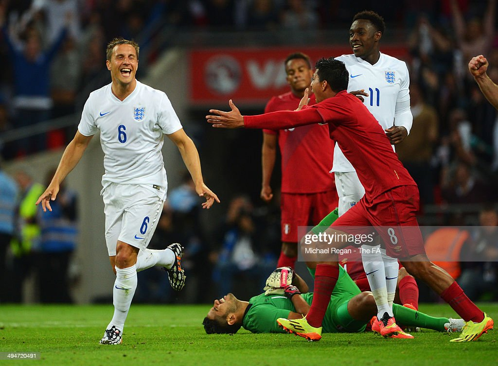 Rinaldo Cruzado of Peru (8) reacts as <a gi-track='captionPersonalityLinkClicked' href=/galleries/search?phrase=Phil+Jagielka&family=editorial&specificpeople=682518 ng-click='$event.stopPropagation()'>Phil Jagielka</a> of England (6) scores their third goal during the International Friendly match between England and Peru at Wembley Stadium on May 30, 2014 in London, England.