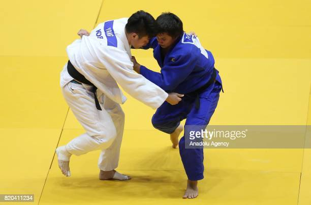Rinat Kadyrov of Russia competes with Jungmu Yang of South Korea during the men's 90 kg Judo match within the 23rd Summer Deaflympics 2017 at Ataturk...