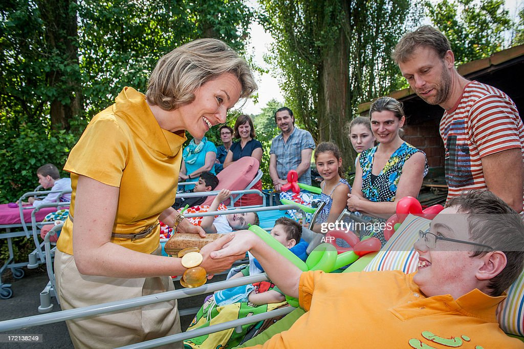 rincess Mathilde of Belgium speaks with children on stretchers as she visits the 'Limmerik' home in Zandhoven on July 2, 2013. 'Limmerik' provides short-term temporary relief for families with seriously ill children.