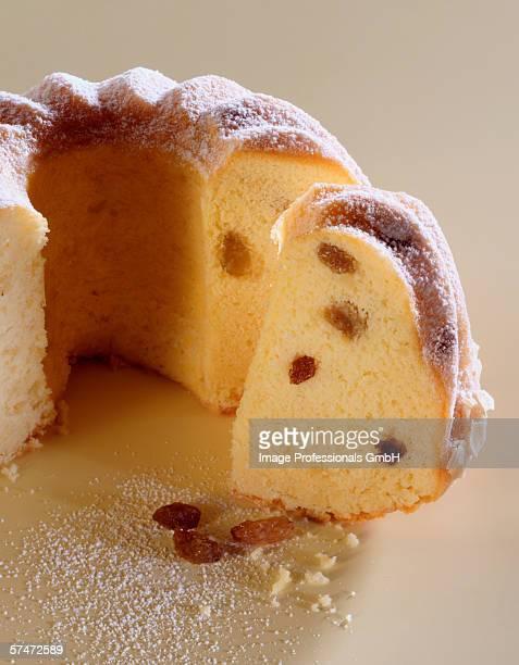 Ring cake with raisins, a piece cut
