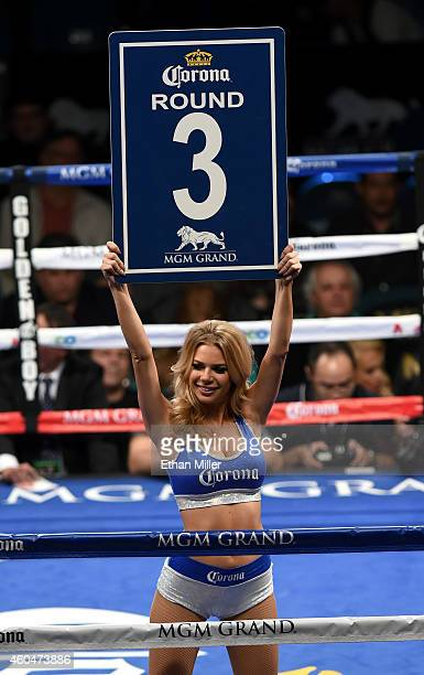 A ring card girl signals the start of round three of the super featherweight bout between Abner Mares and Jose Ramirez at the MGM Grand Garden Arena...