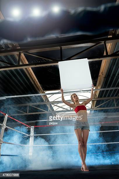 Ring Girl Announcing Start of Round at box match