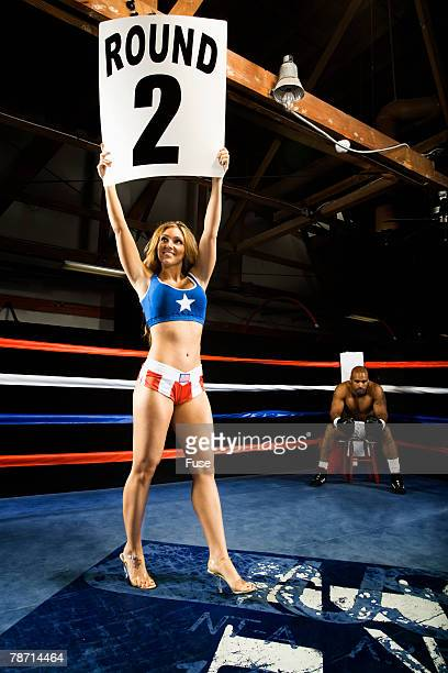Ring Girl Announcing Start of Round Two