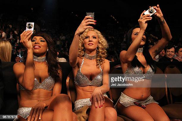 Ring girls take pictures of the featherweight bout between Daniel Ponce De Leon of Mexico and Cornelius Lock at the MGM Grand Garden Arena on May 1...