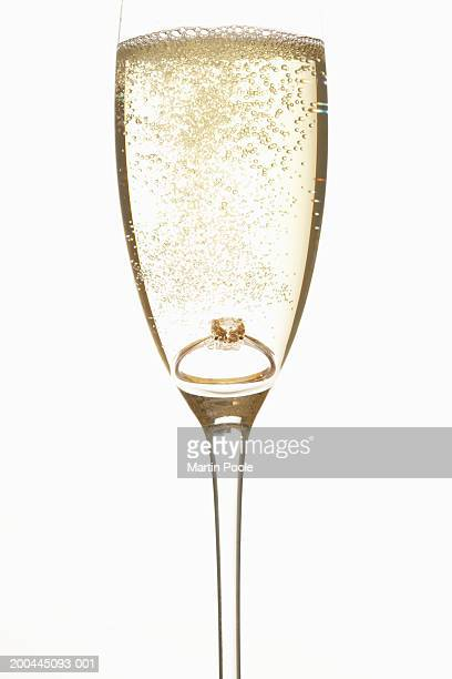 Ring in champagne-filled champagne flute , close-up