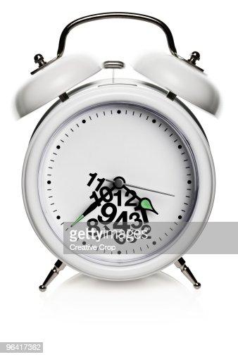 Ringing white alarm clock