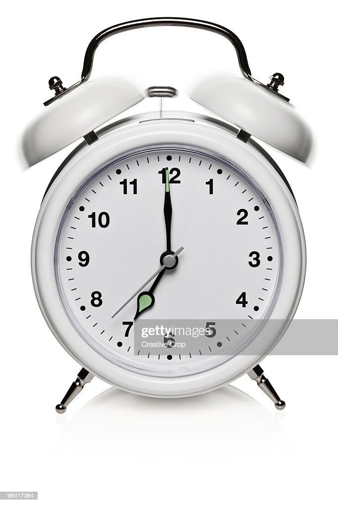 Ringing white alarm clock : Stock Photo