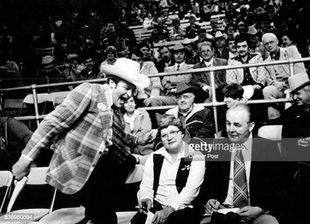 Ringman almost a show himself as he prods Beef Buyers to Boost Bids Evan Slack gamboled Tuesday night as bidding proceeded for 1978 grand champion...