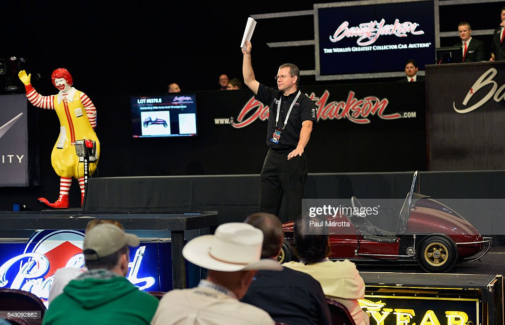Ringmen take bids from prospectiver buyers at the Barrett-Jackson Inaugural Northeast Auction at Mohegan Sun Arena on June 25, 2016 in Uncasville, Connecticut. Organizers estimated app. 70,000 vistors attended the three day auction June 23-25 during which hundreds of collectors were sold at auction.