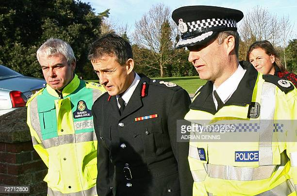 Emergency service personnel Chris Ford of Sussex Ambulance alongside Chief Fire Officer Des Prichard of East Sussex Fire Service and Assistant Chief...