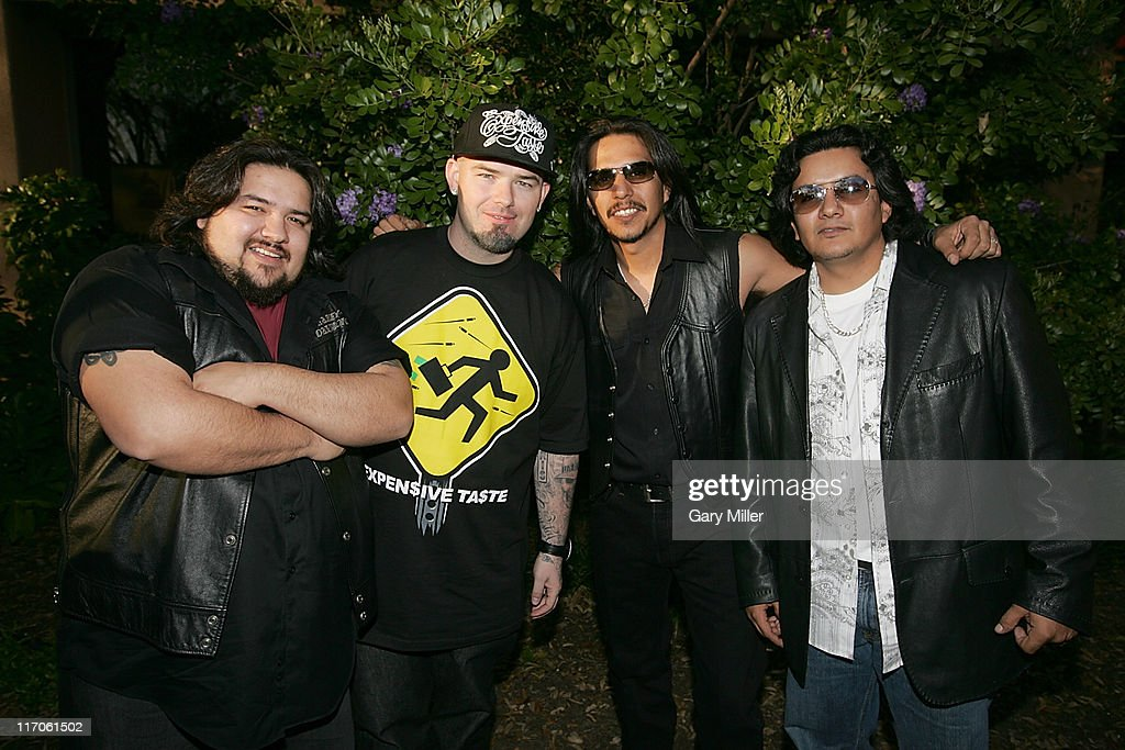 Ringo Garza of Los Lonely Boys, rapper Paul Wall, musicians Jojo Garza and Henry Garza of Los Lonely Boys attend the Recording Academy's Texas Chapter membership drive on the south lawn of the Four Seasons during the South By Southwest Music Festival on March 18, 2010 in Austin, Texas.