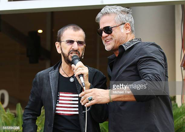 Ringo Starr and Jon Stevens perform onstage during the Ringo Starr Birthday Celebration held in front of the Capitol Records building on July 7 2016...