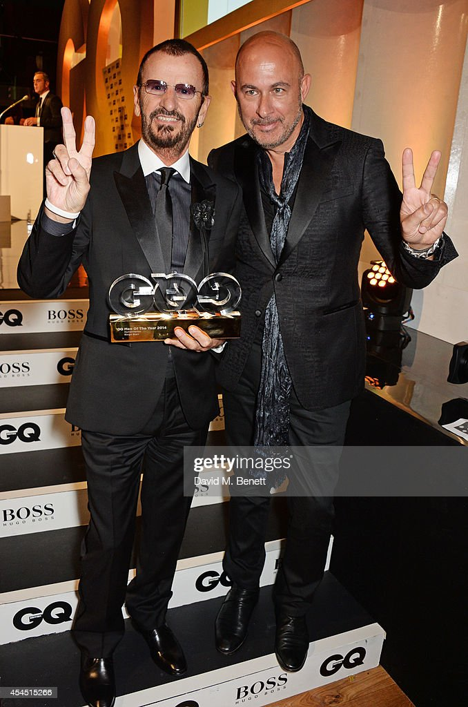 <a gi-track='captionPersonalityLinkClicked' href=/galleries/search?phrase=Ringo+Starr&family=editorial&specificpeople=92463 ng-click='$event.stopPropagation()'>Ringo Starr</a>, winner of the Humanitarian of the Year award (L) and presenter John Varvatos attend the GQ Men Of The Year awards in association with Hugo Boss at The Royal Opera House on September 2, 2014 in London, England.