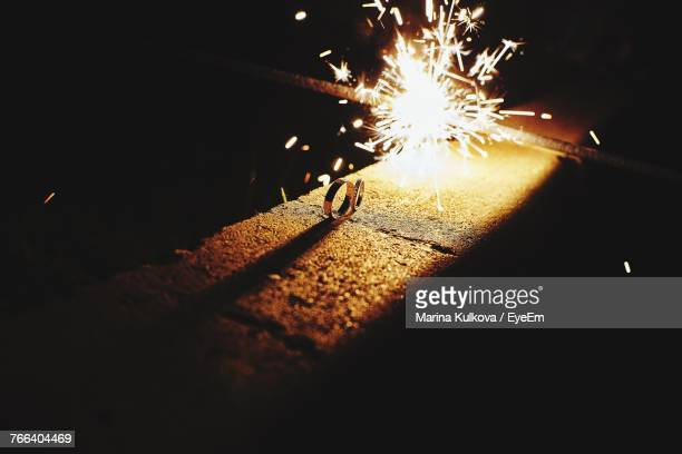Rings By Burning Sparkler On Retaining Wall At Night