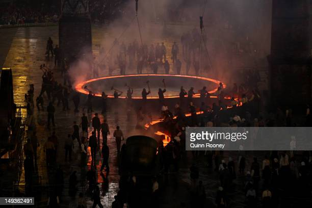 Rings representing both the Olympics and the Industrial Revolution are lit during the Opening Ceremony of the London 2012 Olympic Games at the...