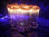 Rings representing both the Olympics and the Industrial Revolution are lit and lifted during the Opening Ceremony of the London 2012 Olympic Games at...