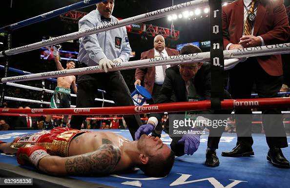 A ringside physician checks on Dejan Zlaticanin after he was knocked out by Mikey Garcia during the third round of their WBC lightweight title fight...