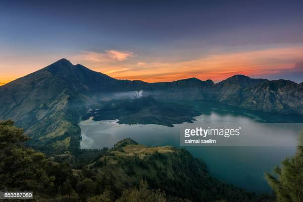 Rinjani mountain and Segara Anak lake at sunrise, Senaru crater rim, Lombok island, Indonesia