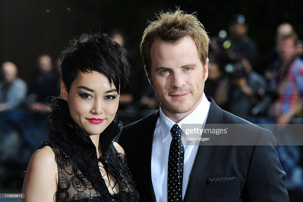 Rinko Kikuchi and Robert Kazinsky attend the European premiere of 'Pacific Rim' at The BFI IMAX on July 4 2013 in London England