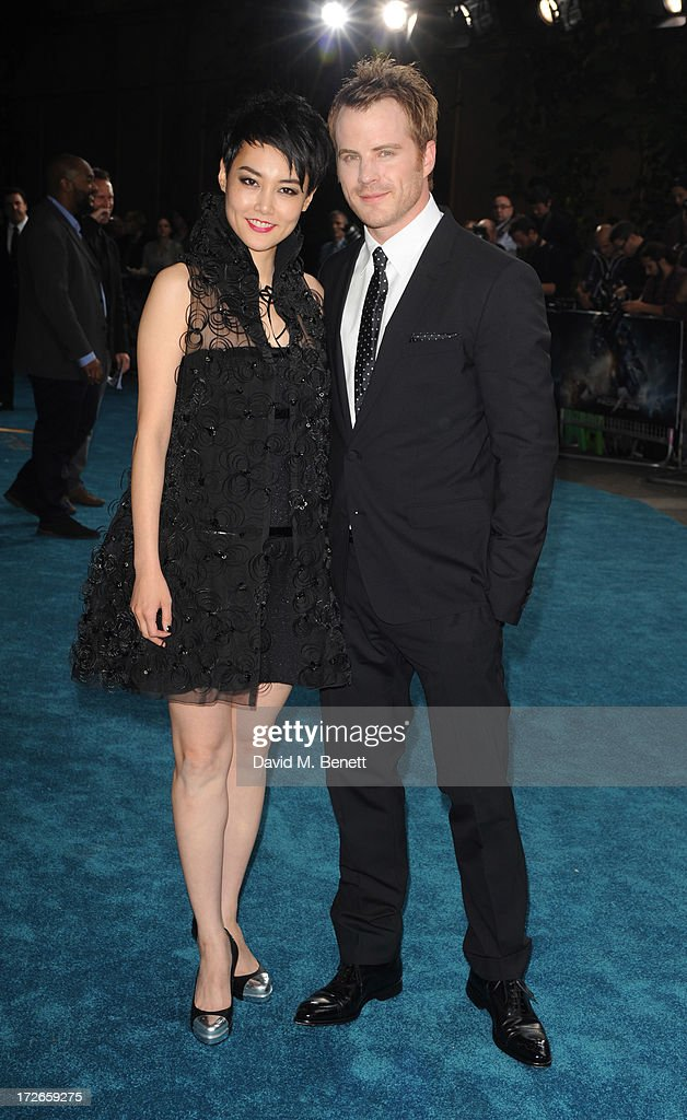 Rinko Kikuchi and Robert Kazinsky attends the European Premiere of 'Pacific Rim' at BFI IMAX on July 4, 2013 in London, England.