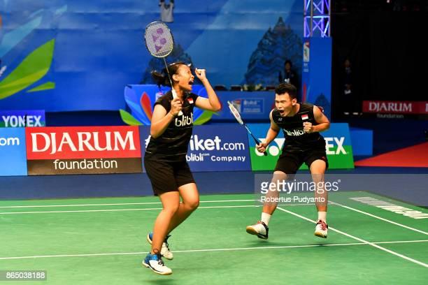 Rinov Rivaldy and Pitha Haningtyas Mentari of Indonesia celebrate victory after beating Rehan Naufal Kusharjanto and Siti Fadia Silva Ramadhanti of...