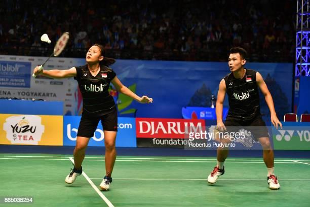 Rinov Rivaldy and Pitha Haningtyas Mentari of Indonesia compete against Rehan Naufal Kusharjanto and Siti Fadia Silva Ramadhanti of Indonesia during...