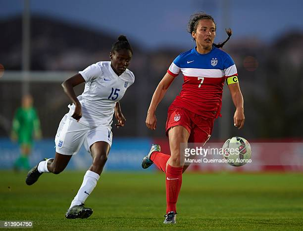 Rinsola Babajide of England competes for the ball with Samantha Hiatt of USA during the women's U19 international friendly match between England U19...