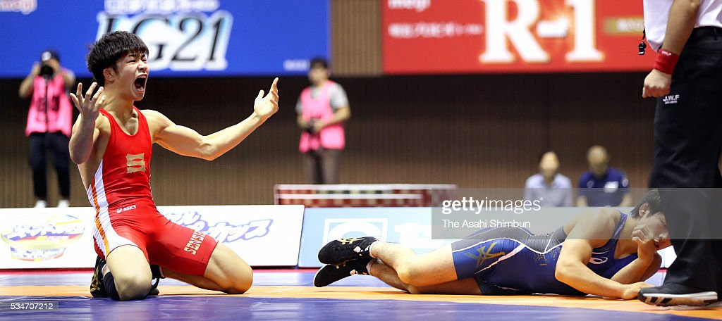 Rinya Nakamura (red) celebrates winning against <a gi-track='captionPersonalityLinkClicked' href=/galleries/search?phrase=Yuki+Takahashi&family=editorial&specificpeople=624879 ng-click='$event.stopPropagation()'>Yuki Takahashi</a> (blue) in the Men's Freestyle -57kg final during day one of the All Japan Wrestling Invitational Championships at the Yoyogi National Gymnasium on May 27, 2016 in Tokyo, Japan.