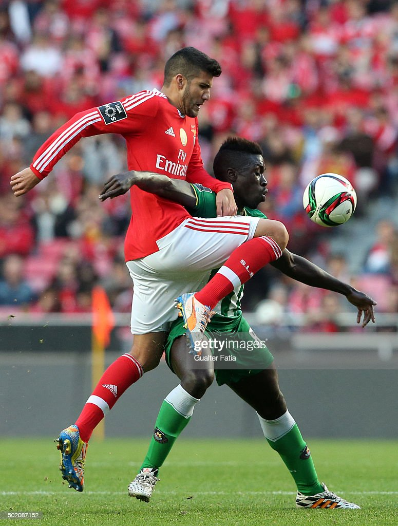 Rio Ave FC's forward Yazalde with SL Benfica's defender <a gi-track='captionPersonalityLinkClicked' href=/galleries/search?phrase=Lisandro+Lopez&family=editorial&specificpeople=801562 ng-click='$event.stopPropagation()'>Lisandro Lopez</a> in action during the Primeira Liga match between SL Benfica and Rio Ave FC at Estadio da Luz on December 20, 2015 in Lisbon, Portugal.