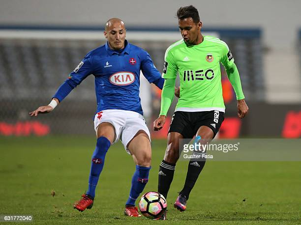 Rio Ave FC's midfielder Filipe Augusto with Belenenses's midfielder Hassan Yebda from Argelia in action during the Primeira Liga match between CF Os...